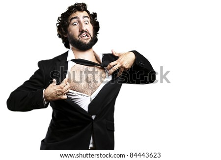 portrait of young business man tearing his suit over white - stock photo
