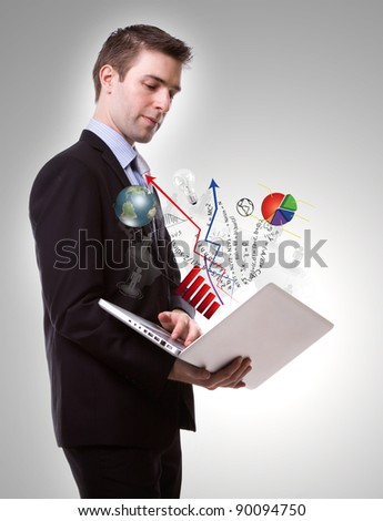 Portrait of young business man with laptop - stock photo