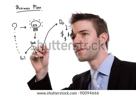 Portrait of young business man writing business plan against white background - stock photo