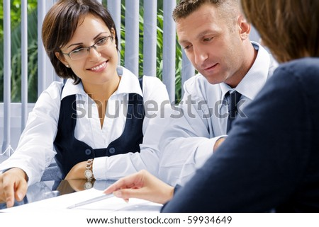 Portrait of young business people  discussing project in office environment