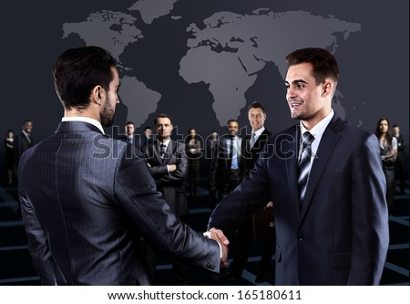 Portrait of young business people. Handshake in front of business people - stock photo