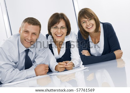 Portrait of young business people  in office environment - stock photo