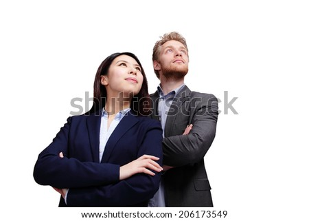 Portrait of young business people looking to the future isolated on white background, caucasian and asian