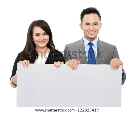 Portrait of young business team holding a big blank card for text - stock photo