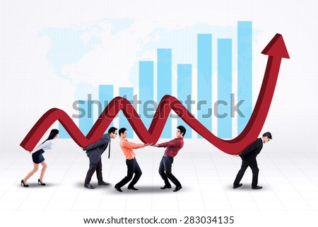 Portrait of young business team work together to carry a business graph with upward arrow - stock photo