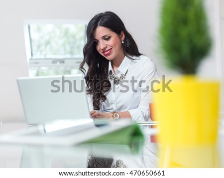 portrait of young business woman at modern startup office interior