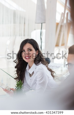 portrait of young business woman at modern startup office interior working on new project - stock photo