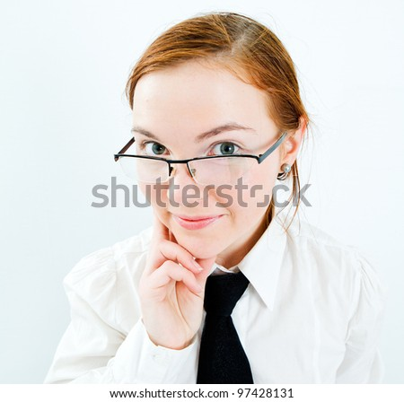 Portrait of young business woman at white background.