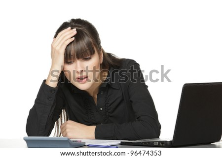 Portrait of young business woman calculating at office - stock photo