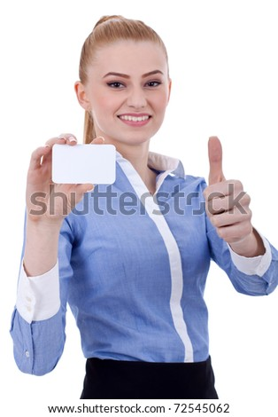 Portrait of young business woman holding blank business card giving thumbs up isolated on white background - stock photo