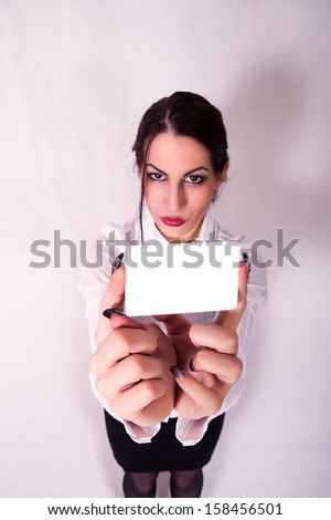 portrait of young business woman holding credit card - stock photo