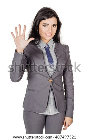 portrait of young business woman in gray suit showing five fingers. Hand counting. isolated on white background. business and lifestyle concept - stock photo
