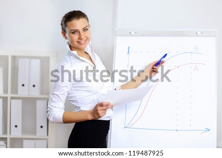 Portrait of young business woman in office - stock photo