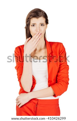 portrait of young business woman in red suit covering closed mouth with hands. Speak no evil concept isolated white wall background. Human emotion face expression sign symbol. - stock photo