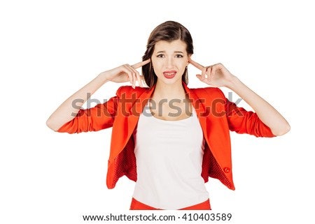 portrait of young business woman in red suit covering her ears with hands. isolated on white background. business and lifestyle concept - stock photo