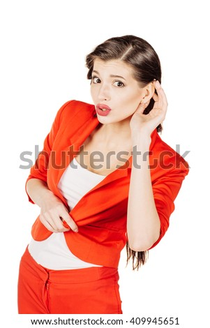 portrait of young business woman in red suit listening gossip. isolated on white background. business and lifestyle concept - stock photo