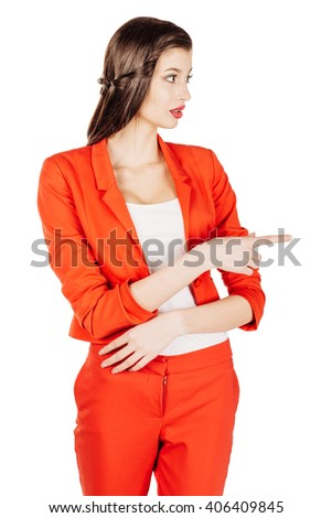 portrait of young business woman in red suit pointing and showing copy space. isolated on white background. business and lifestyle concept - stock photo