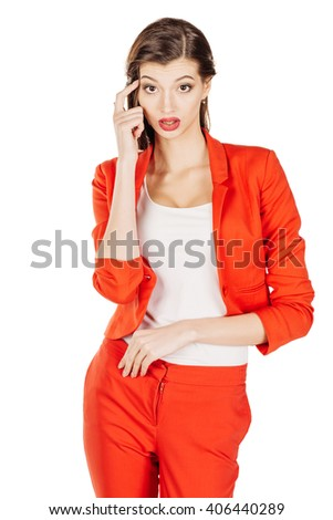 portrait of young business woman in red suit with her finger against temple asking are you crazy?. isolated on white background. Negative emotions facial expression feeling body language