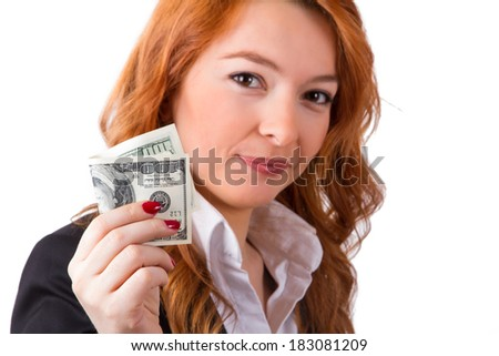 Portrait of young business woman in suit showing dollars, isolated on white background.