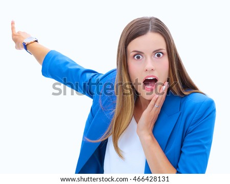 Portrait of young business woman pointing.
