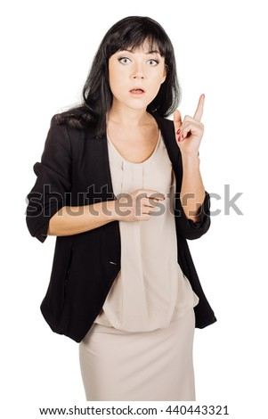 portrait of young business woman pointing up and showing copy space. isolated on white background. business idea and lifestyle concept - stock photo
