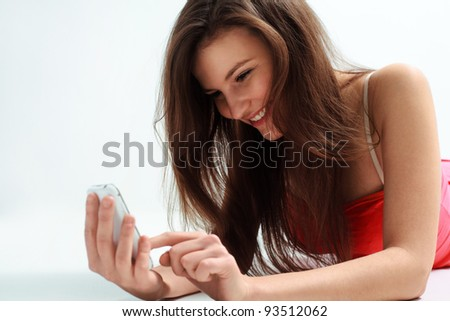 Portrait of Young business woman using a cellphone - stock photo