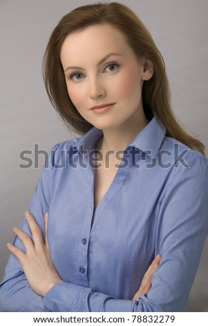 Portrait of young business woman with chestnut hair and in dark blue blouse - stock photo