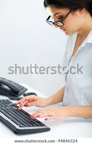Portrait of young business woman working on computer at office
