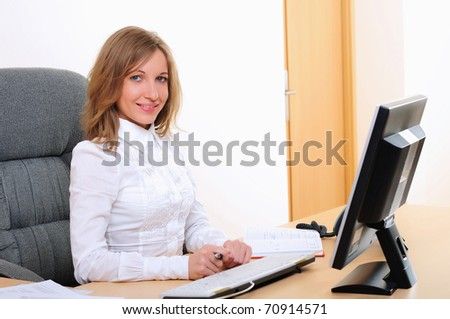 Portrait of young business woman working on the computer.