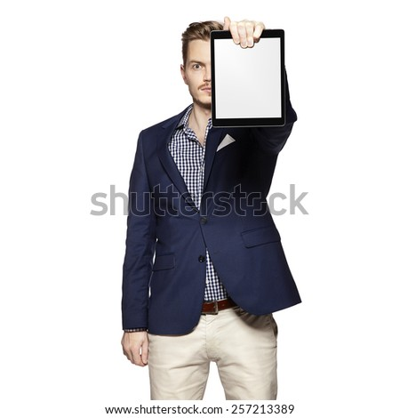Portrait of young businessman holding a blank digital tablet. - stock photo