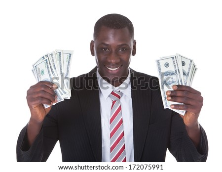 Portrait Of Young Businessman Holding Banknotes Over White Background - stock photo