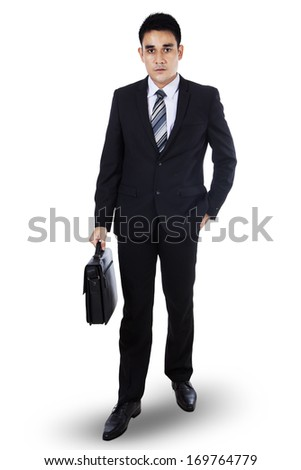 Portrait of young businessman holding briefcase in hand isolated on white - stock photo
