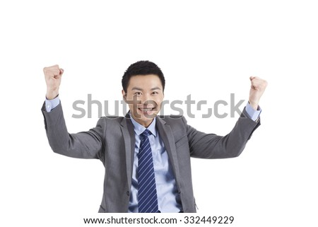 Portrait of young businessman holding up fists,standing in white background