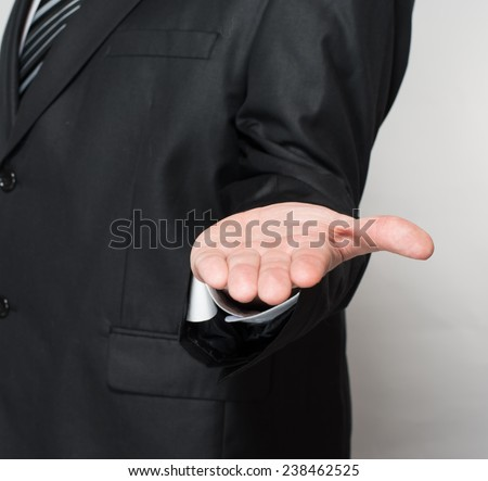 Portrait Of  Young Businessman In A Suit Holds Out His Hand For A Handshake  - stock photo