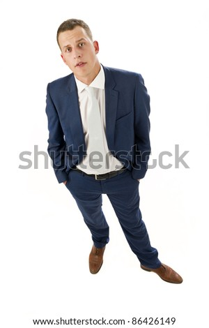 Portrait of young, businessman in blue suit on white background - stock photo