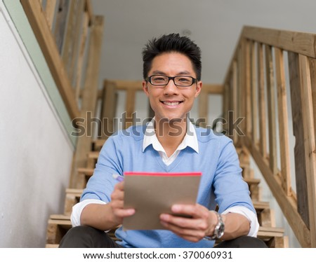 Portrait of young businessman in casual