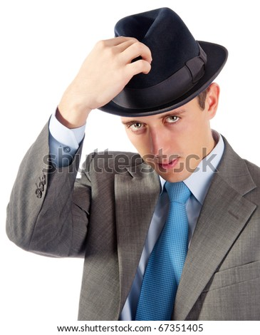 Portrait of young businessman in hat. Isolated on white