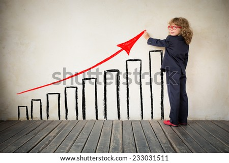Portrait of young businessman in modern loft office. Drawn bar chart. Success in business concept. Copy space for your text - stock photo