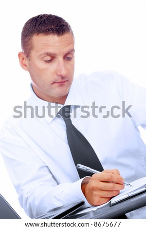 portrait of young businessman in office environment