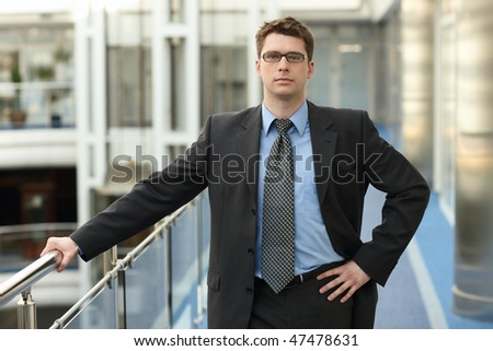 portrait of young businessman in office space smile