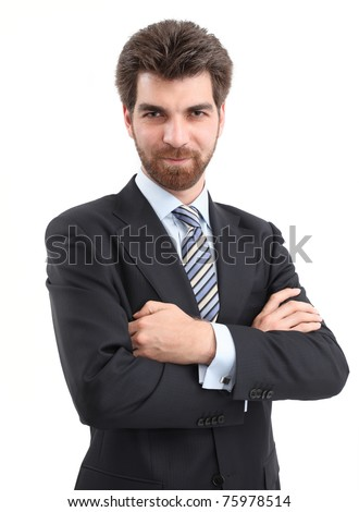 Portrait of young businessman is standing with arms crossed and looking at camera.