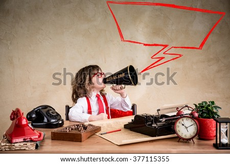 Portrait of young businessman kid in office. Success business communication concept