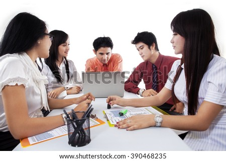 Portrait of young businessman leads a business meeting in the office, isolated over white - stock photo