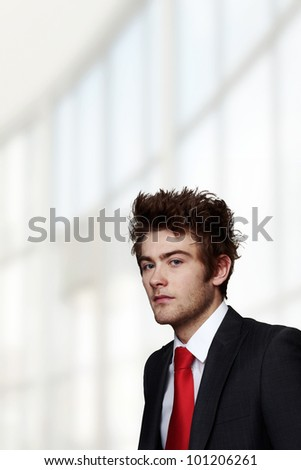 portrait of young businessman looking into camera