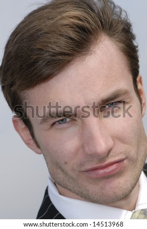 portrait of  young businessman on  background of  sky