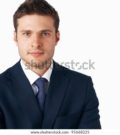 Portrait of young businessman on white background, looking at you.