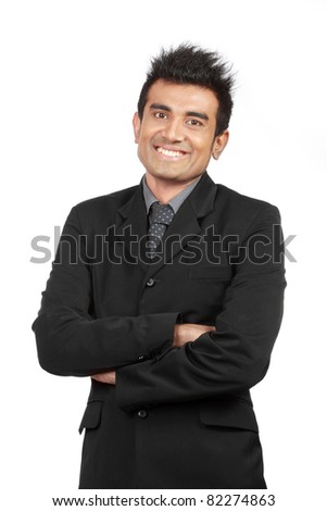portrait of young businessman smiling - stock photo