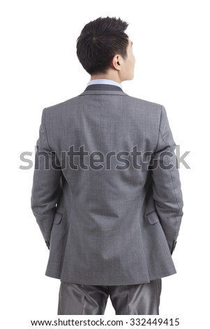 Portrait of young businessman standing in white background,back view