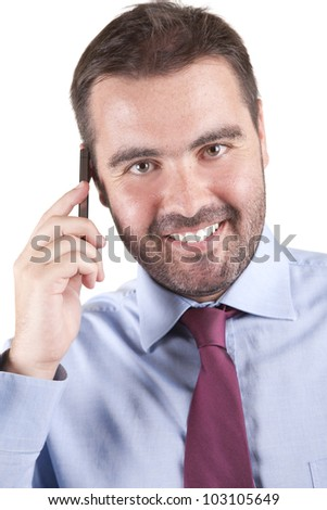 Portrait of young businessman talking on mobile phone. Isolated on white - stock photo