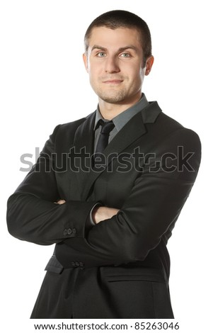 Portrait of young businessman with hands folded isolated on white background - stock photo